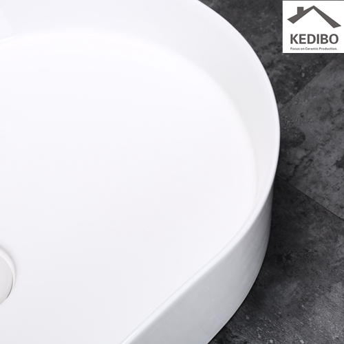 600x380 New Product Slim Oval Ceramic Bathroom Wash Basin Sink 0055
